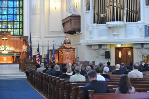 (Nathan A. Wilkes/U.S. Navy) Chief of Navy Chaplains Rear Adm. Margaret Grun Kibben delivers a sermon during a worship service to celebrate the Navy's 239th birthday at the U.S. Naval Academy chapel.