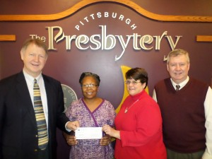 Mission Possible Therapies received $15,000 from the Synod of the Trinity's SDOP committee recently. Pictured are, from left, Sheldon Sorge, general minister; Clarice Johnson of Mission Possible; Carla Campbell, stated clerk; and Doug Portz, senior associate minister.