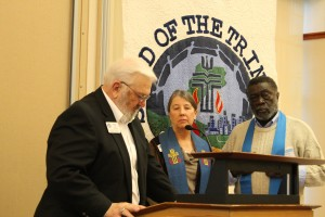 Stated Clerk Wayne Yost installs Moderator Barbara Chaapel and Vice Moderator Johnnie Monroe during a ceremony Monday morning.