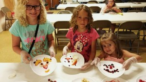 """These """"Kids in the Kitchen"""" had some creative fun with their fruit plates during the Summer Food Service Program."""