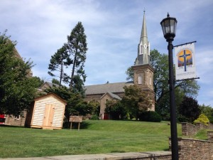 """A replica """"Log Church"""" sits in the shadow of the current Abington Presbyterian Church near Philadelphia. The log building was constructed in honor of the first building that housed the congregation nearly 300 years ago."""