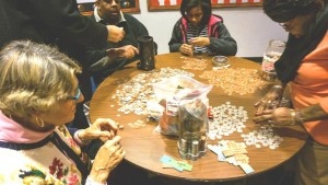 Members of COR count their Penny Fund following a recent worship service in Pittsburgh.