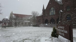 "Amid falling snow, Calvary Presbyterian Church in Indiana sits adjacent to Graystone Presbyterian Church, two congregations that have seen their worshipers move ""across the lawn"" on several occasions."