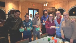 Teachers and students from the Uniontown English is a Second Language class hold up the Easter eggs they decorated during class. The ESL program was organized by Tricia Patton of Third Presbyterian Church.