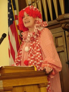 The Rev. Elizabeth Campbell-Maleke delivers a sermon dressed as Raggedy Ann during Holy Humor Sunday at First Presbyterian Church of Williamstown, WV.
