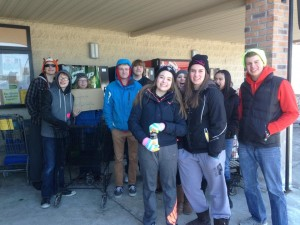 Cold and hungry youth stand outside in search of food to donate to local food banks.