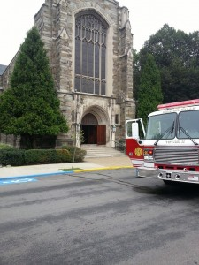 A fire truck sits outside First Presbyterian Church of Beaver Falls following an elevator engine fire that left the building filled with smoke.