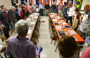 Volunteers gather to give thanks and ask a blessing before the meal is served at the Feeding of the 500 at First Presbyterian Church 1793 of Washington, PA.