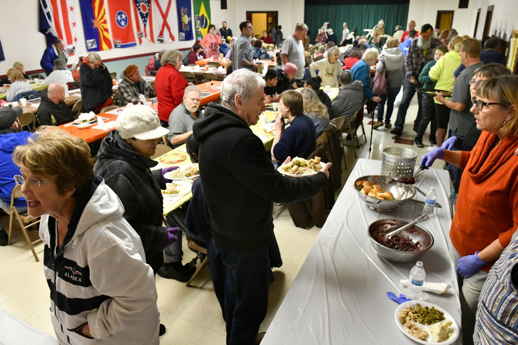 The basement social room welcomes members and friends of First Presbyterian Church 1793 for the free community holiday meal called the Feeding of the 500 in Washington, PA.